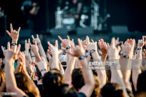 Music fans enjoying the heat making the rock horns hand gesture on Day 5 of the 52nd Festival D'été Quebec on the Bell Stage at the Plains of Abraham...