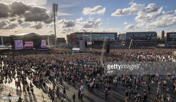 Music fans gather at the One Love Manchester benefit concert for the families of the victims of the May 22 Manchester terror attack at Emirates Old...