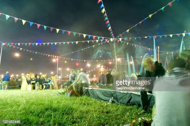 Music Fans gather in a common area by night on the fourth day of Glastonbury Festival at Worthy Farm on June 27, 2010 in Glastonbury, England.