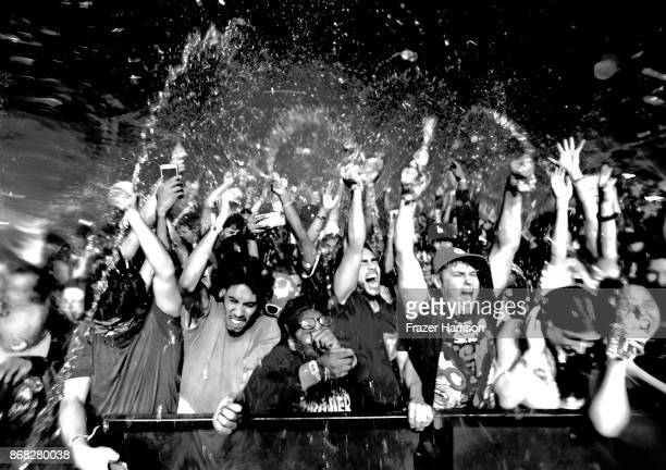 Image converted to black and white Music fans have a water fight during Lil Yachty set at Camp Flog Gnaw Carnival 2017 Day 2 Exposition Park on...