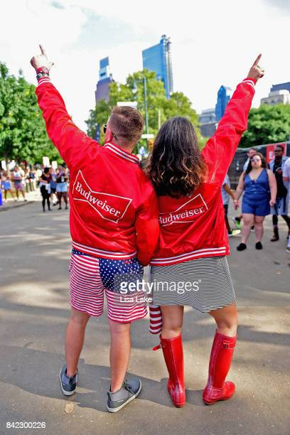Music fans in Budweiser jackets pose during the 2017 Budweiser Made in America festival Day 2 at Benjamin Franklin Parkway on September 3 2017 in...