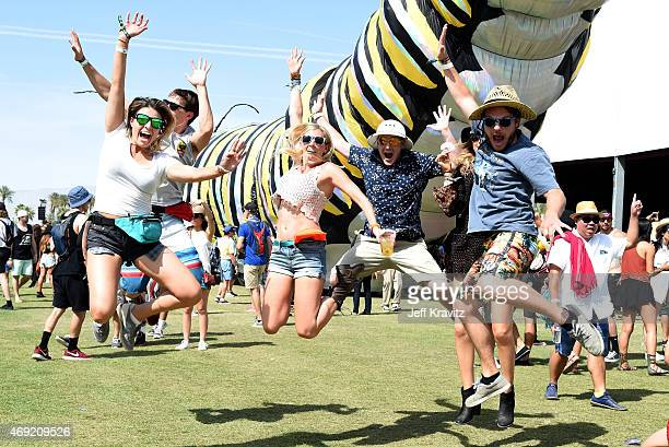 Music fans jump infront of the Papilio Merraculous art installation by Poetic Kinetics during day 1 of the 2015 Coachella Valley Music Arts Festival...