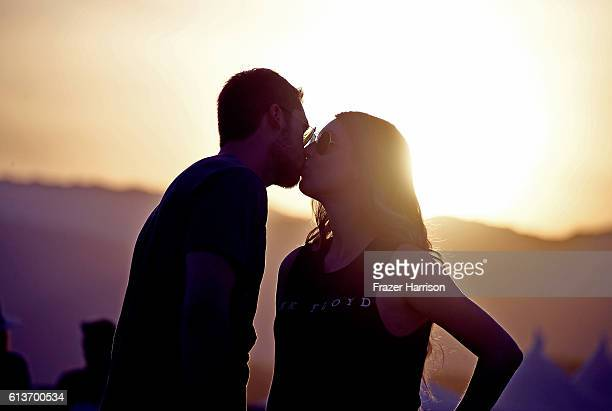 Music fans kiss during the sunset at Desert Trip at the Empire Polo Field on October 9 2016 in Indio California