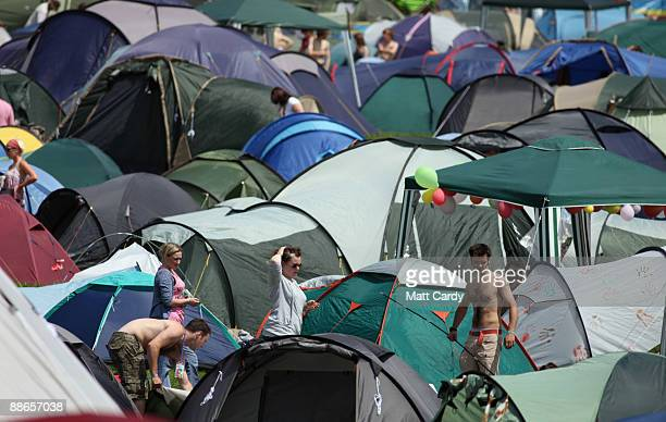 Music fans look to pitch a tent as people start to arrive at the Glastonbury Festival site at Worthy Farm, Pilton on June 24, 2009 near Glastonbury,...
