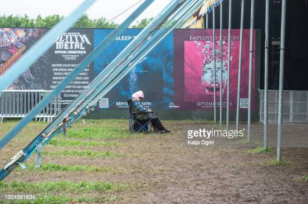 Music fans on day three of the Download PILOT festival at Donington Park on June 20, 2021 in Donington, England. Download PILOT is a 10,000 capacity...