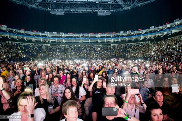 Music fans on the front row enjoy the atmosphere during Kisstory, The Blast Off Tour at The O2 Arena on March 11, 2020 in London, England.