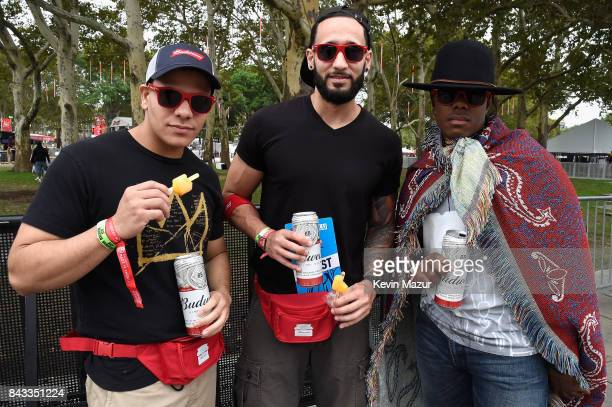 Music fans pose with Budweiser beverages and swag in the Bud Block area during 2017 Budweiser Made in America Day 1 at Benjamin Franklin Parkway on...