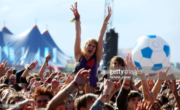 Music fans soak up the atmposhere as You Me At Six perform live on the Main stage during the third and final day of Reading Festival on August 29...