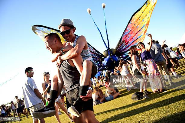 Music fans stand in front of Papilio Merraculous art installation by Poetic Kinetics during day 3 of the 2015 Coachella Valley Music Arts Festival at...