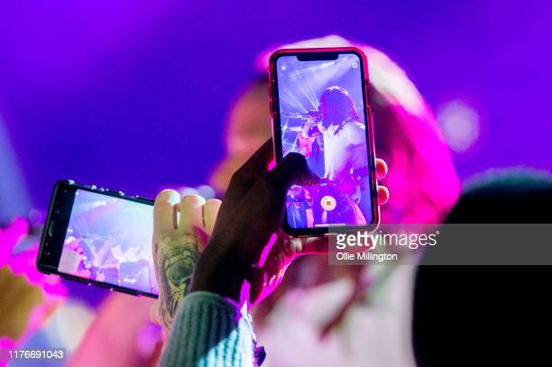 September 23: Music fans take photographs with mobile phones as Fetty Wap performs on stage at o2 Forum Kentish Town on September 23, 2019 in London,...