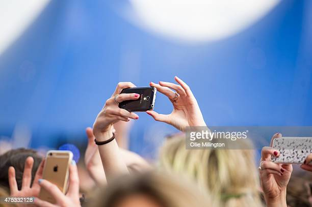 music fans taking photographs with mobile phones during day 1 of We Are FSTVL at Damyns Hall Upminster on May 30 2015 in London United Kingdom