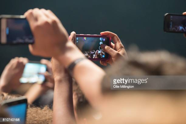Music fans using their phones in the crowd as Kendrick Lamar performs onstage headlining Day 2 of the 50th Festival D'ete De Quebec on the main stage...