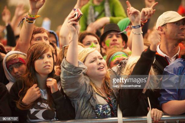 Music fans watch a performance on the last day of Leeds Festival at Bramham Park on August 30 2009 in Leeds England