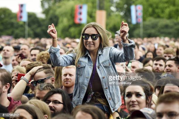 Music fans watch as Rag 'N' Bone Man performs on the main Stage at the TRNSMT music Festival on Glasgow Green in Glasgow on July 7 2017 PHOTO / Andy...
