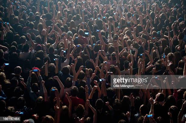 Music fans watch on with hands in the air as Imagine Dragons perform during the bands April UK tour at The Institute on April 9 2013 in Birmingham...