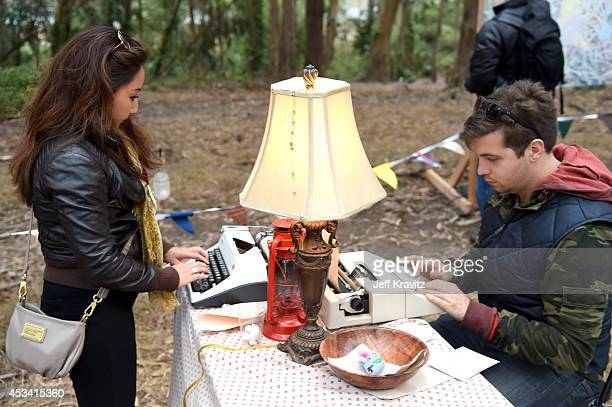 Music fans write messages on typewriters at Digital Detox Analog Zone during day 2 of the 2014 Outside Lands Music and Arts Festival at Golden Gate...