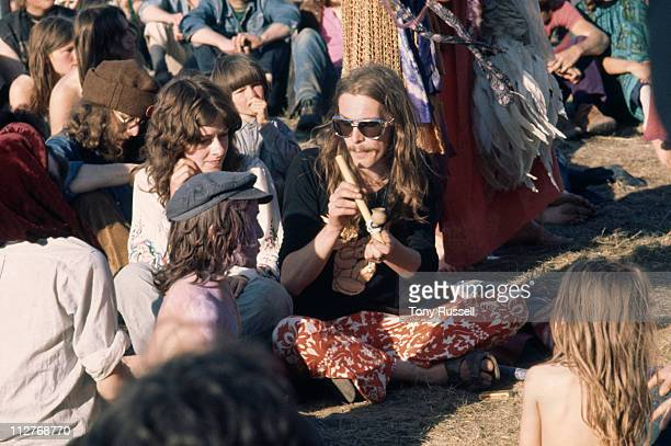 Music festival goers passing around a pipe in the crowd at the Isle of Wight Festival on the Isle of Wight England Great Britain 26 August 1970