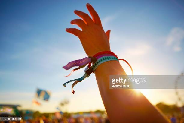 music festival hand waving - festival goer stock pictures, royalty-free photos & images