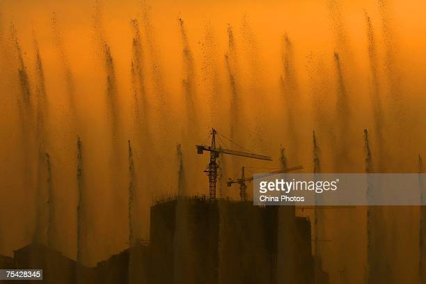 A music fountain is seen in front of a construction site on July 15 2007 in Erdo China Erdos is an industrial city in northern China and its major...
