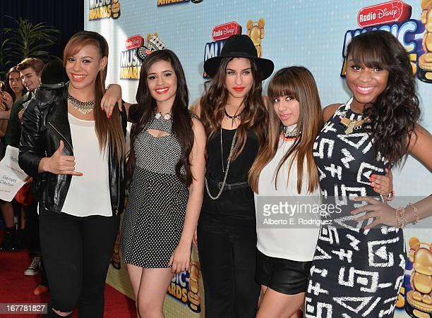 Music group Fifth Harmony members Dinah Jane Hansen, Camila Cabello, Lauren Jauregui, Ally Brooke Hernandez and Normani Hamilton arrive to the 2013...