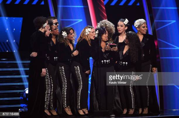 Music group Flor de Toloache accept Best Ranchera/Mariachi Music Album for 'Las Caras Lindas' onstage at the 18th Annual Latin Grammy Awards at MGM...