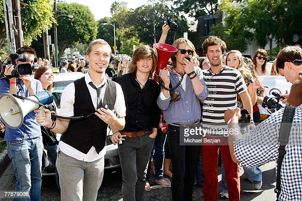 7aa47e94598 Music group Hanson and Blake Mycoskie speak to the crowd at the Hanson and TOMS  Shoes