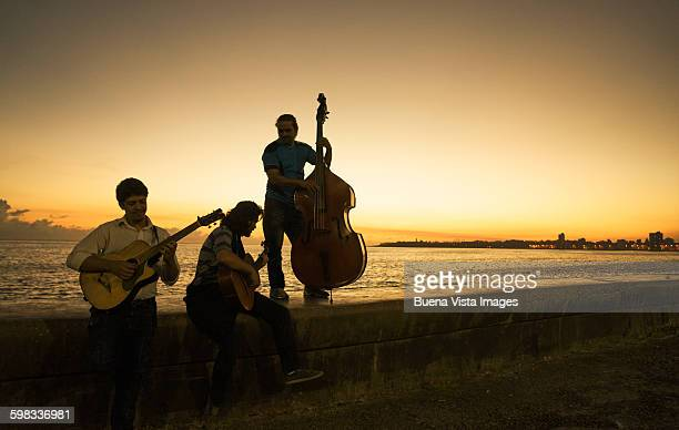 Music group on El Malecon at sunrise
