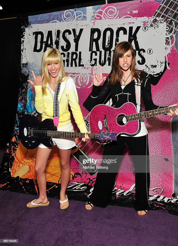 Music group Savvy and Mandy pose with Daisy Rock Girl Guitars at the Baby & Tween Celebration trade show held at the Los Angeles Convention Center on April 25, 2009 in Los Angeles, California.