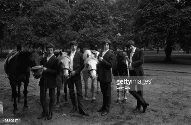 Music group 'The Kinks' posing on Rotten Row with horses Peter Quaife Mick Avory Dave Davies and Ray Davies London August 21st 1964