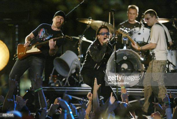 Music group U2 performs during halftime of Super Bowl XXXVI February 3 2002 at the Superdome in New Orleans LA Super Bowl XXXVI is being played by...