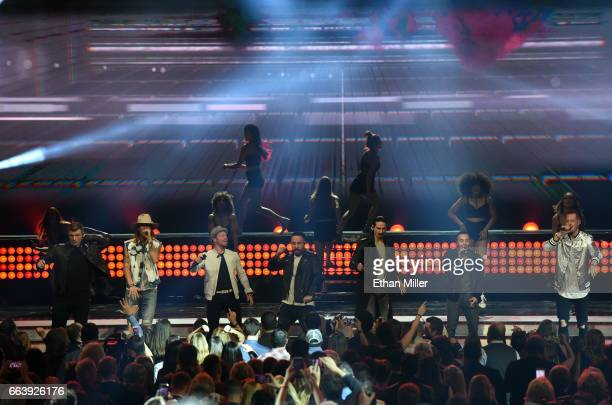 Music groups Florida Georgia Line and Backstreet Boys perform onstage during the 52nd Academy of Country Music Awards at TMobile Arena on April 2...