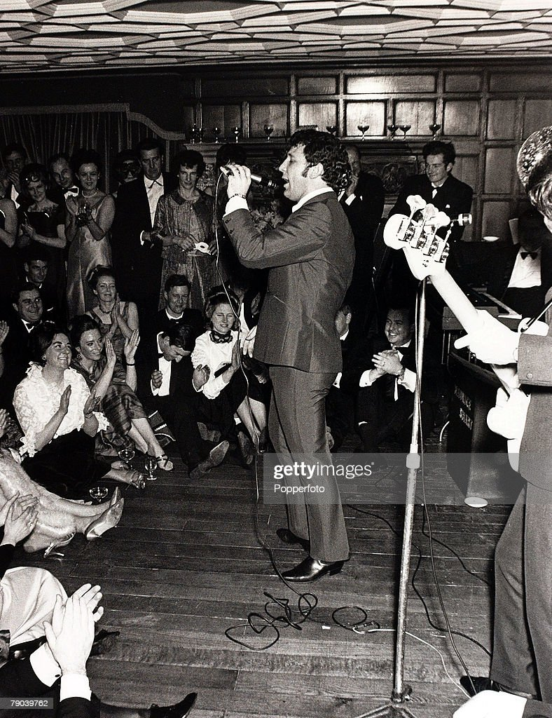 Music. High Wycombe, England. 11th February 1967. Welsh pop singer Tom Jones entertaining an enthusiastic audience at a charity ball. : News Photo