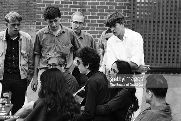 Music impresario Albert Grossman singer songwriter Bob Dylan folk singer Joan Baez and folksinger Mimi Farina perform and mingle with fans at the...