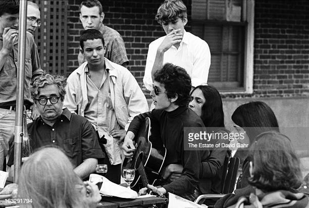 Music impresario Albert Grossman singer songwriter Bob Dylan folk singer Joan Baez and folksinger Mimi Farina perform and mingle with fans at the...