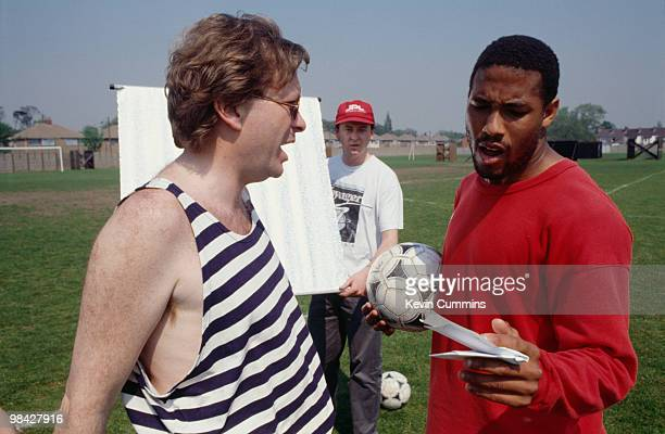 Music impresario Tony Wilson with footballer John Barnes during the filming of the video for the official song of the England football team's 1990...