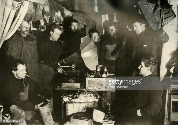 Music in the Hut' circa 1908 Expedition members gather round a gramophone player AngloIrish explorer Ernest Shackleton made three expeditions to the...