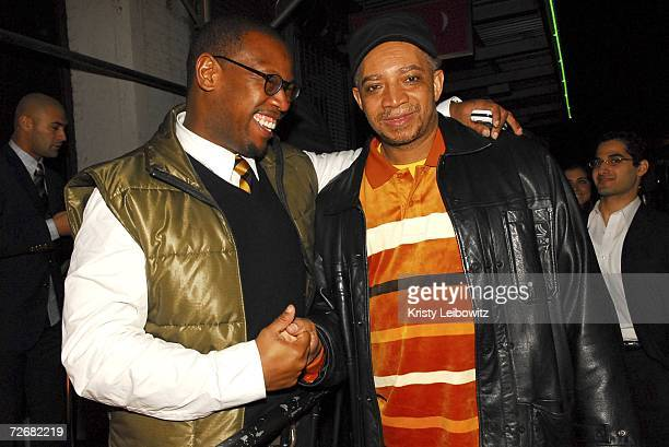 Music industry mobile Andre Hurrell and DJ Red Alert pose at Rev Run's birthday celebration at Tenjune on November 29 2006 in New York City
