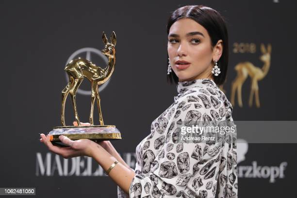'Music International' award winner Dua Lipa poses with her award during the 70th Bambi Awards winners board at Stage Theater on November 16 2018 in...