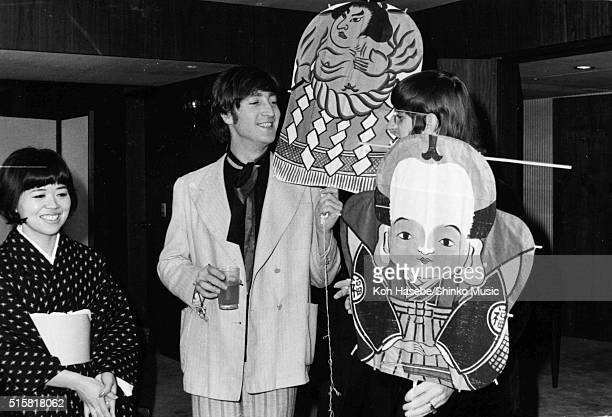 Music journalist Rumi Hoshika with John Lennon and Ringo Starr of The Beatles holding a gift kite during an interview with Japanese music magazine...