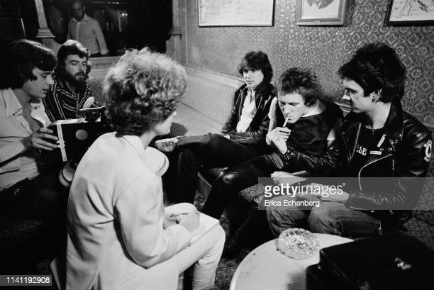 Music journalists Danny Baker Marc Perry and Kris Needs being filmed for a punk documentary in a pub in Soho London 1977