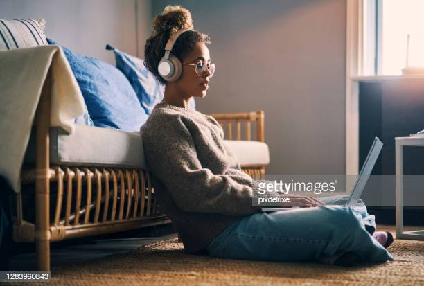 music keeps her productive - multimedia stock pictures, royalty-free photos & images
