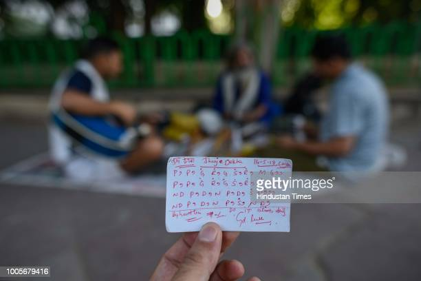 Music learner shows a note given to him by Guitar Rao outside Andhra Bhawan, on May 22, 2018 in New Delhi, India. Guitar Rao's day begins at 4 a.m...