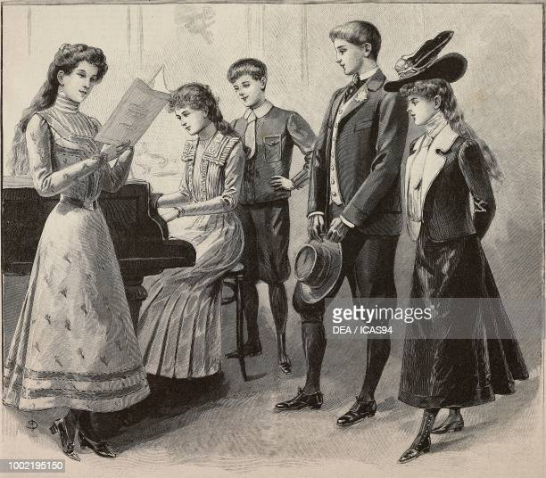 girls and boys aged 1114 in fashionable clothes a girl playing the piano models by Magasins du Louvre engraving from La Mode Illustree No 8 February...