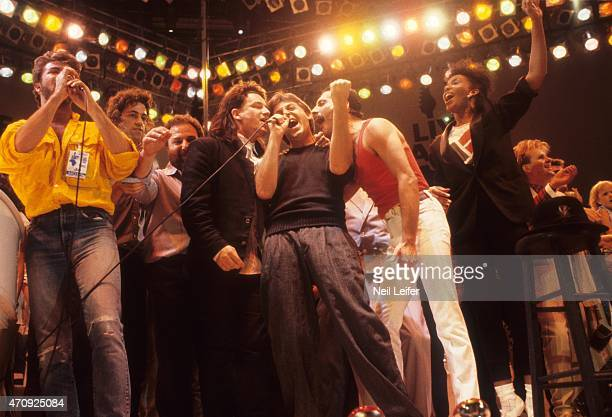 Live Aid George Michael of Wham Bob Geldof Bono of U2 Paul McCartney Freddie Mercury of Queen performing on stage during the finale at Wembley...