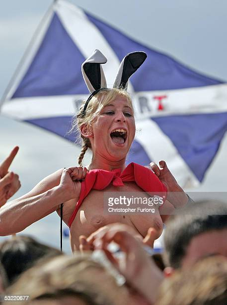A music lover endure the intense heat at T In The Park 2005 at Balado on July 10 2005 at Kinross Scotland