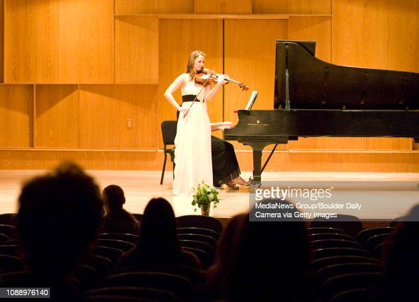 Music lovers watch while University of Colorado student Stephanie Mientka plays her viola on Friday Feb 25 during a Senior Recital at the Grusin...