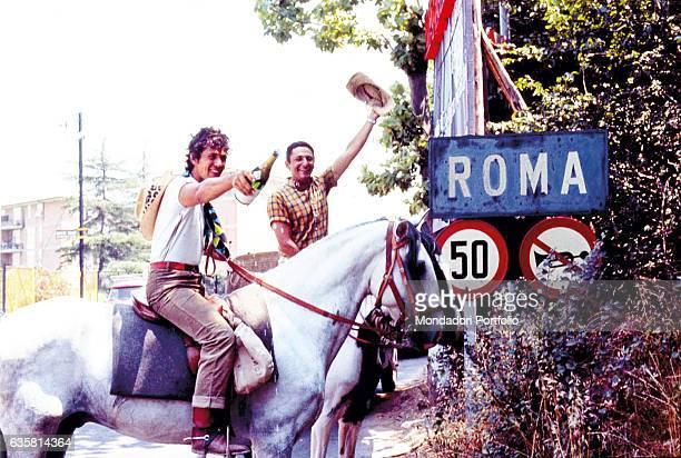 Music lyricist Mogol and singer Lucio Battisti riding horses around Rome Rome 1960s