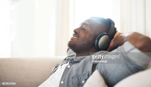 music makes all seem good in the world - contented emotion stock pictures, royalty-free photos & images