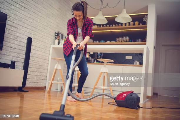 music makes cleaning easy - tv housewife stock photos and pictures