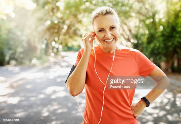 music makes the road seem shorter - sports clothing stock pictures, royalty-free photos & images